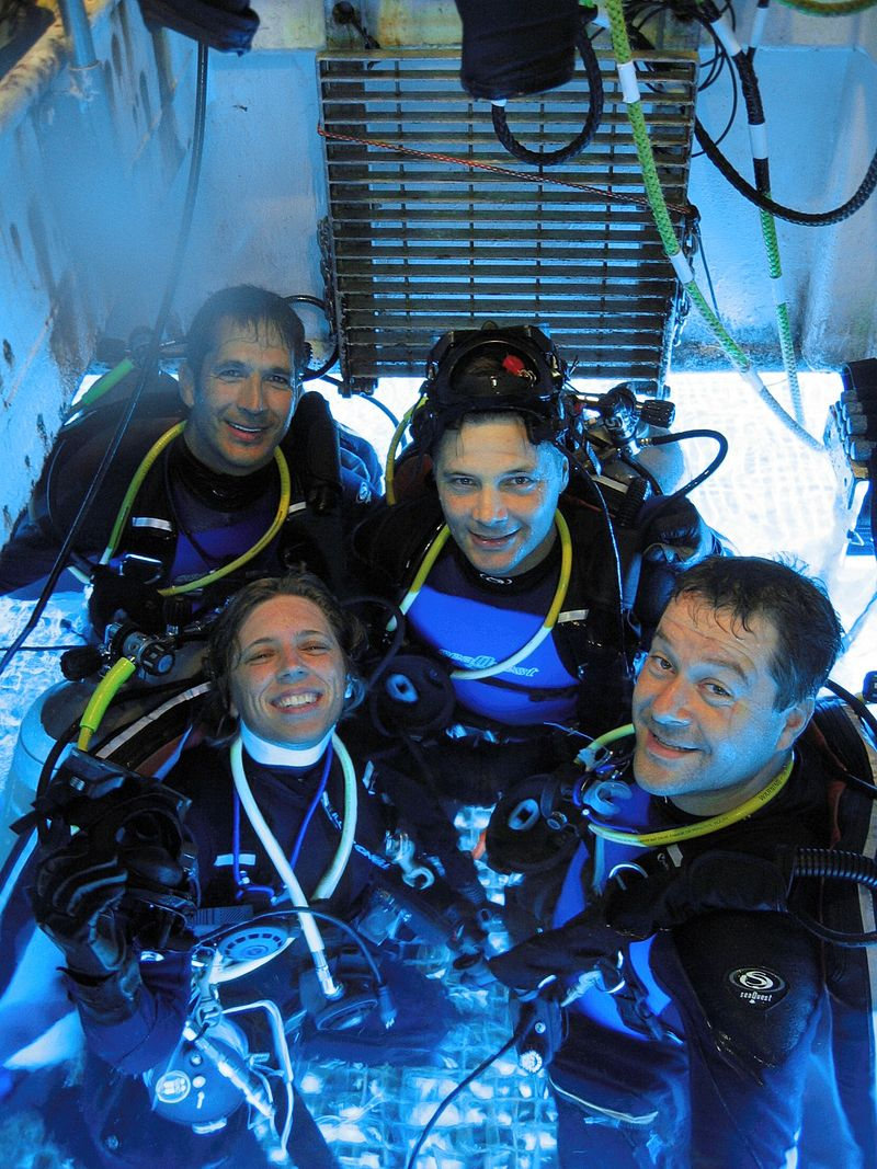 The crew of NEEMO 6 in the moonpool of Aquarius